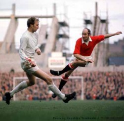 Bobby Charlton, and brother Jacky, in action